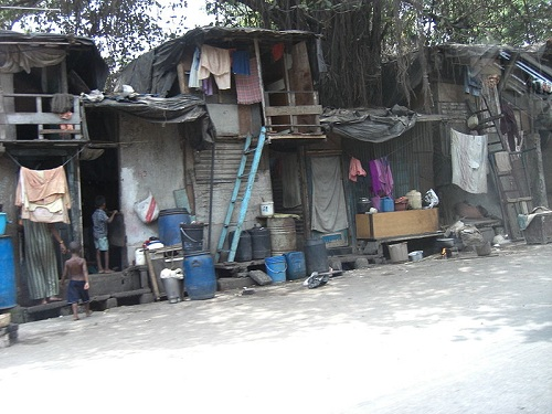 Slum in Mumbai, India. 55% of the population of Mumbai live in slums, which cover only 6% of the city's land. Slum growth rate in Mumbai is greater than the general urban growth rate